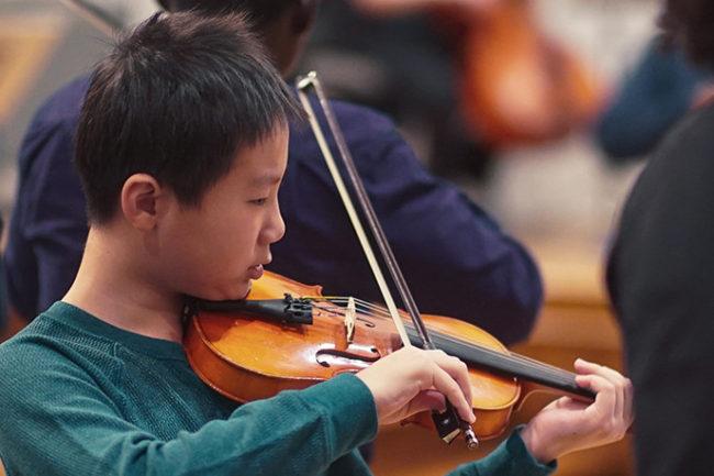 Boy playing violin banner image